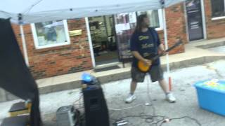 One Man Band live performances outside of Solaris Gallery in Versailles, Ky