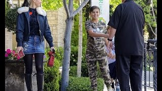 Gwen Stefani leads eldest son Kingston by the hand as she takes her three boys to church...