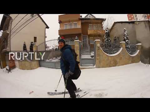 Pristina residents go street skiing during Kosovo cold-snap