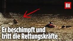 Schwimmer schreit erst nach Hilfe und wehrt sich dann brutal gegen seine Rettung