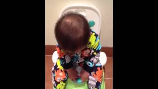 10 month old practicing sitting on the potty