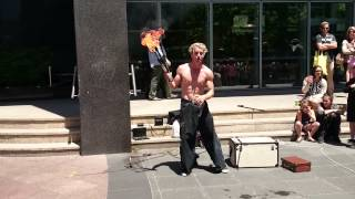 Street performer Melbourne sword swallowing while juggling fire Aerial Manx