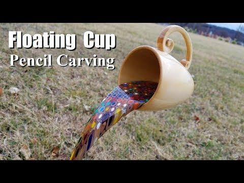 Watch a craftsman turn wood and colored pencils into a floating cup carving