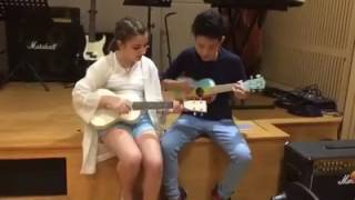 Vu Cat Tuong and Milana play ukulele