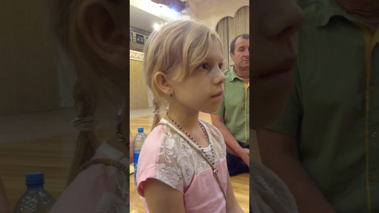 A sweet little Russian girl learns the Indian music notes in her first lesson.