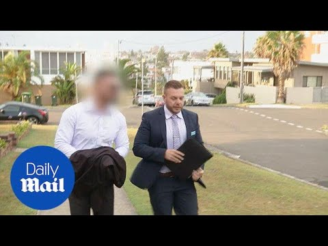 Salim Mehajer is accompanied by a detective after being arrested - Daily Mail