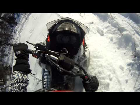 13 year old riding technical snowmobile riding in Alaska