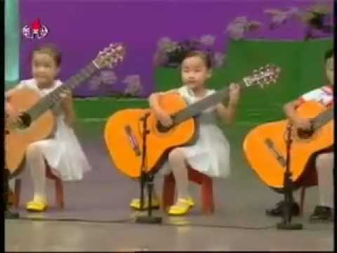 North Korea children playing the guitar.