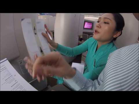 Stewardess in Ao Dai Vietnam Airlines Business Class Trailer