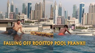 FALLING OFF ROOFTOP POOL PRANK ON MY COUSIN!!