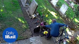 Shocking moment flowers are STOLEN from family grave