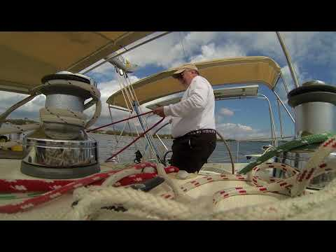FAT MAN TACKS A SAILBOAT