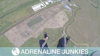 Skydiver Perfectly Lands Onto A Bale Of Hay
