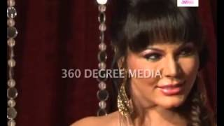 Rakhi Sawant poses for media at the Zee Rishtey awards, shows off tattoos on her body