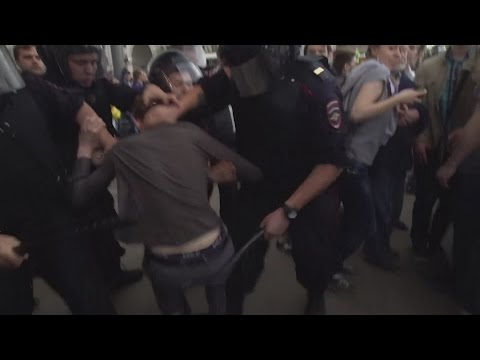 'We won't stay silent': Protesters beaten at anti-Putin rallies in Russia
