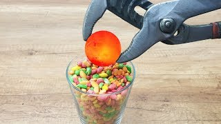 EXPERIMENT Glowing 1000 degree METAL BALL vs RAINBOW RICE