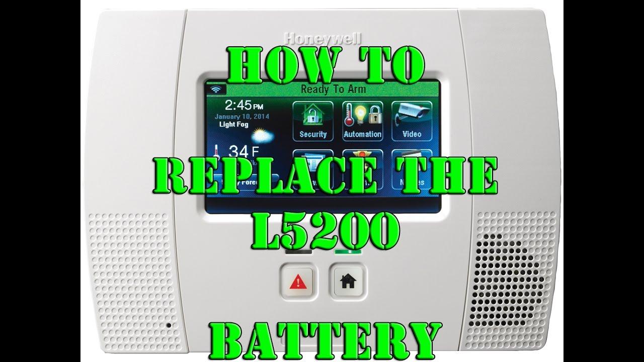 honeywell alarm panel how to change battery