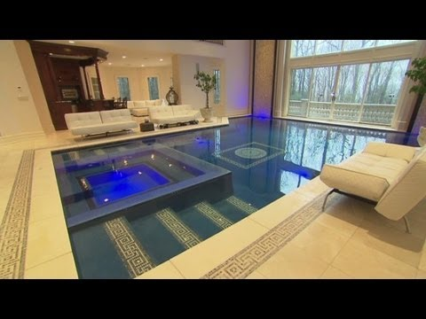 Mansion for sale swim in your living room youtube for Houses with swimming pools inside for sale