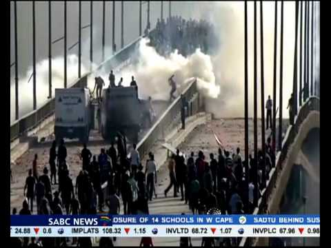 Supporters of Muslim Brotherhood set the Giza government building in Cairo on fire.