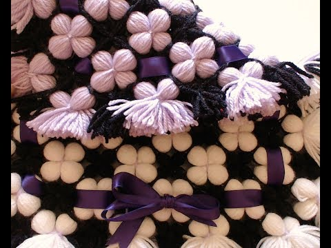 Pom pom blanket.  LOOK the reversible 3D puffy flower blanket