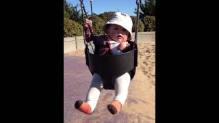 Alina at the park (first swing)