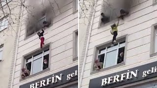 video: Watch: Mother throws children from third floor window of burning building