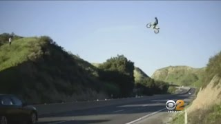 Dangerous Stunt - Video Shows Man On Dirt Bike Flying Over Freeway In Moreno Valley(The stunning video shot from the air and ground was posted on Kyle Katsandris' instagram account. Tom Wait reports., 2017-03-04T07:24:58.000Z)
