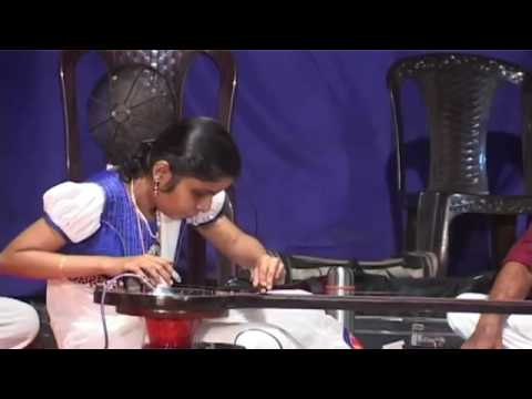Blind girl playing an electronic veena like instrument