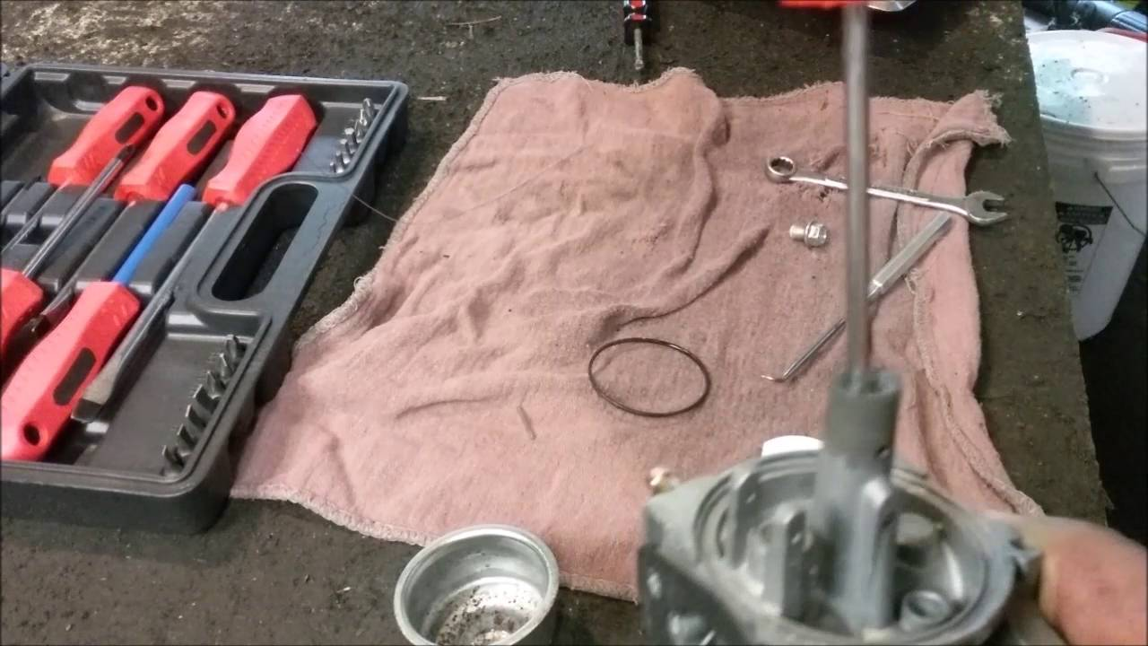 hight resolution of cleaning a champion generator carburetor