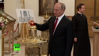 Putin visits Russian Orthodox Church in Paris