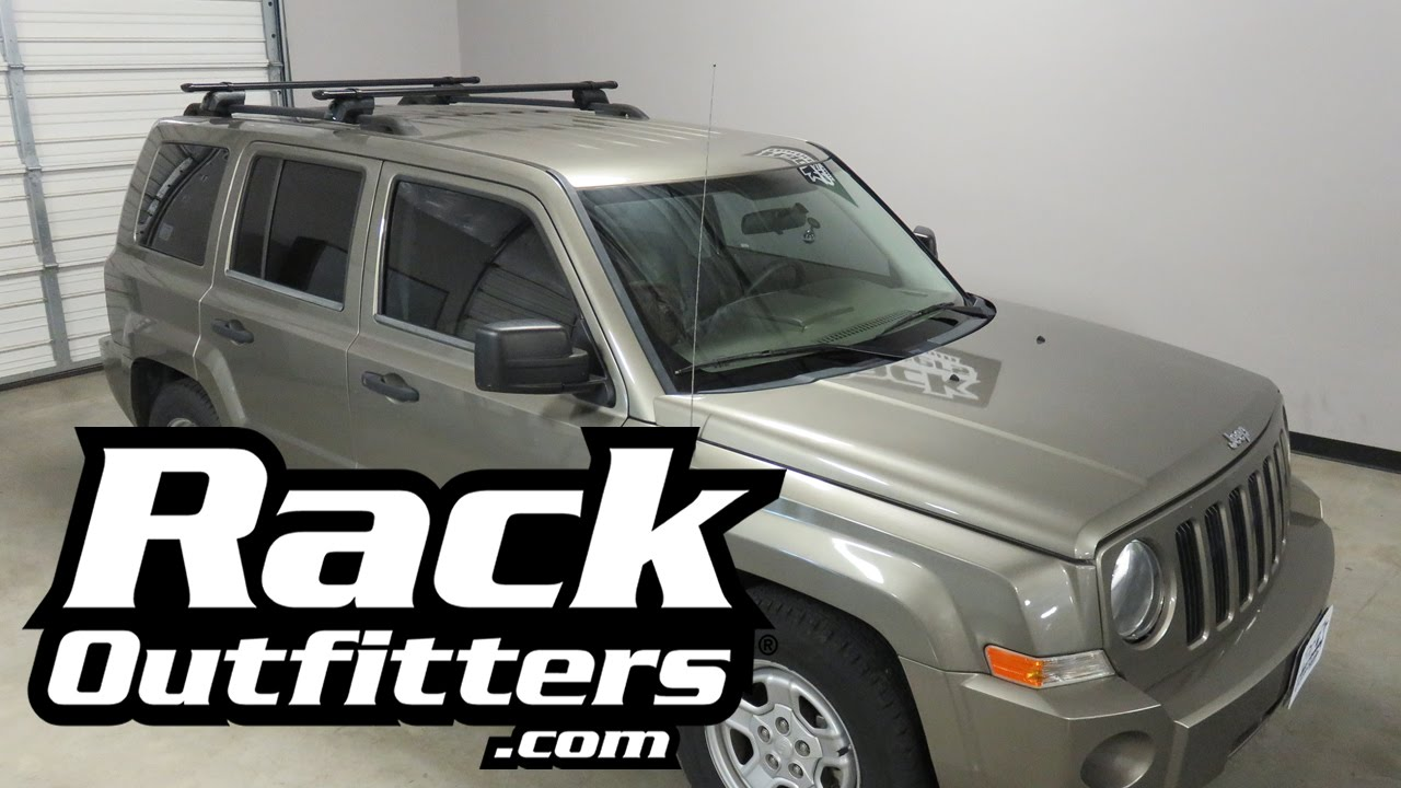 jeep patriot outfitted with yakima timberline corebar roof rack