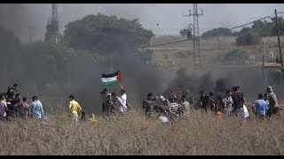 Palestinians protest in Israeli Fire Along The Gaza Border