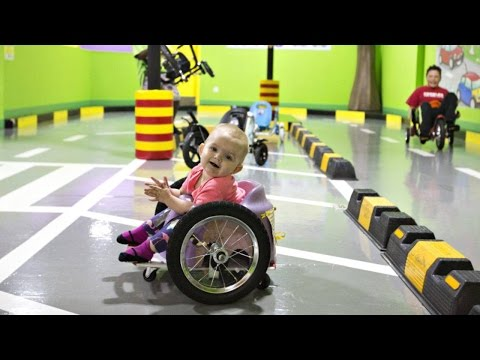 Toddler With Paralysis Zips Around In Homemade Wheelchair