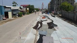 New concrete road parallel to Phnom Penh's main canal is nearing completion