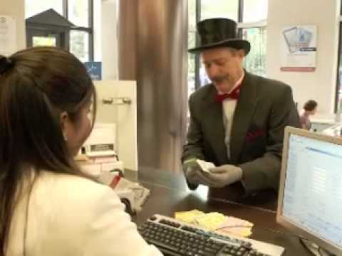 Mr. Monopoly exchanges money for Monopoly Money Makes It Real contest