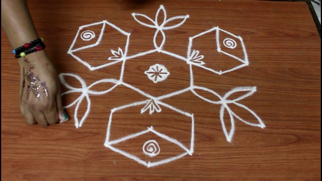 Simple Rangoli Design With Interlaced 7 4 Dots Simple Kolam With 7