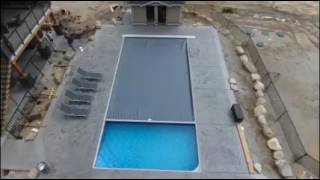 Automatic safety pool cover installation by Poolpatrol.