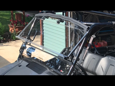 Honda pioneer 100. Hard coat windscreen flip out.