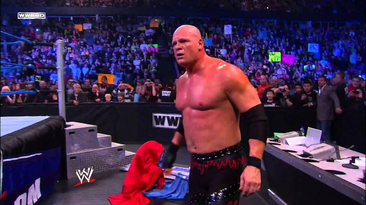 Undertaker Pulls Kane Under The Ring