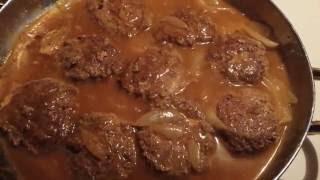 Hamburger patties with onions and gravy