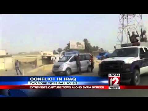 Iraq militia parades as insurgents seize crossing