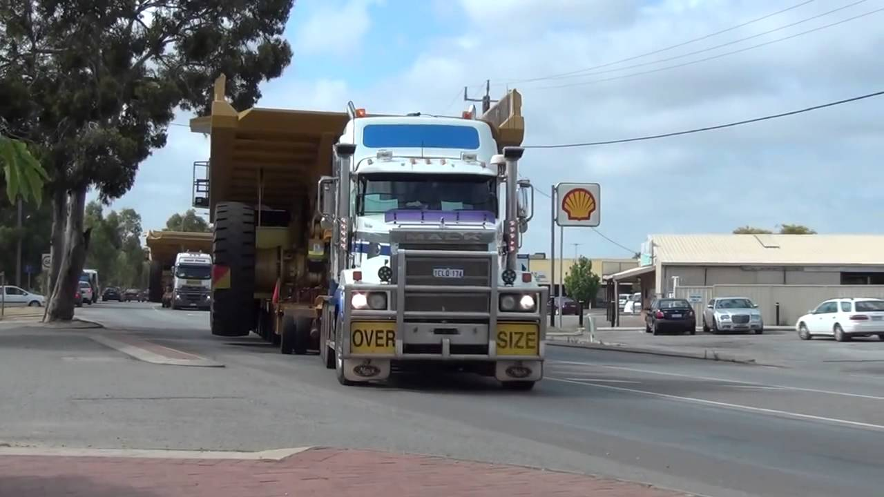 caterpillar 785c dump truck tri drive mack titan with [ 1280 x 720 Pixel ]