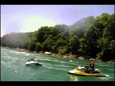 Seadoo jetski jumping waves in the Niagara River Rapids, Whirlpool. Boat sinking
