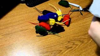 Распаковка игрушек для животных в виде разноцветных мышек с пищалкой