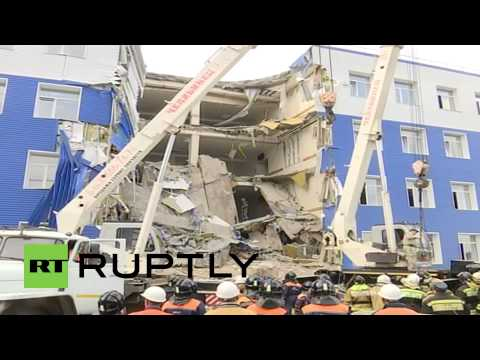Russia: Firefighters battle to find survivors from Omsk barracks