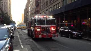 FDNY ENGINE 65 RESPONDING ON WEST 38TH STREET IN THE MIDTOWN AREA OF MANHATTAN IN NEW YORK CITY.