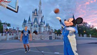 Mickey Mouse plays basketball at Magic Kingdom with Orlando Magic star Aaron Gordon