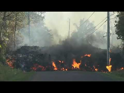 Time lapse video - Hawaii Lava swallows car