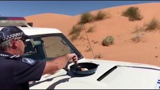 شاهد.. شرطي استرالي يستخدم سيارته لإعداد البيض المقلي