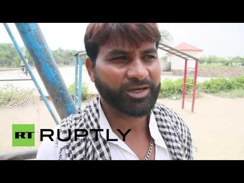 India: Meet the mighty monkey catchers of Delhi
